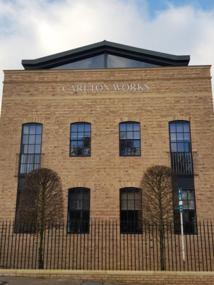 Steel windows add warehouse appeal to new apartments