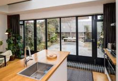 Designer selects steel entrance screen for extension to her 1930s home
