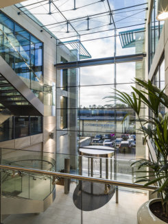 Stunning structurally glazed atrium provides focal point for wealth management firm HQ